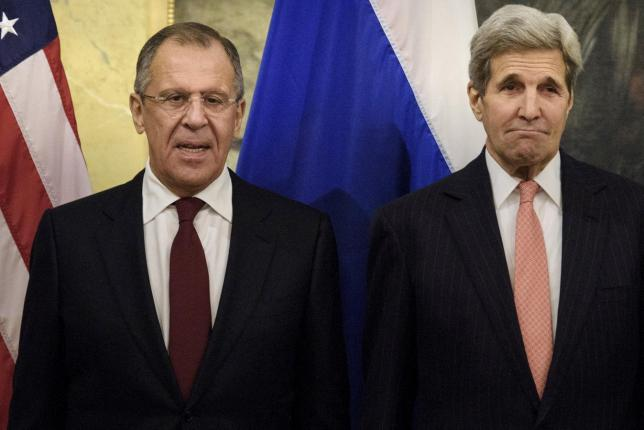 Russian Foreign Minister Lavrov stand with U.S. Secretary of State Kerry before a meeting in Vienna, Austria